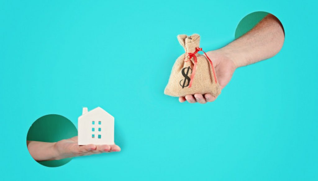 hands-paper-holes-holding-house-bag-with-money_72402-796