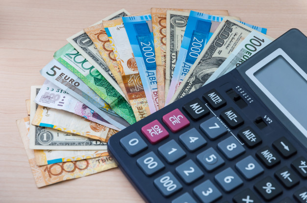 different-banknotes-different-denominations-are-stacked-fan-calculator-table_76263-43